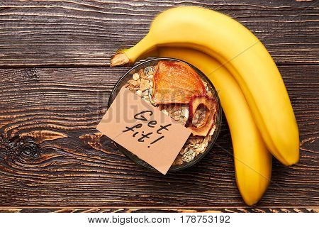 Muesli and bananas on wood. Today is a new beginning.