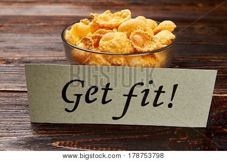 Cornflakes in bowl and card. Easy way to get fit.