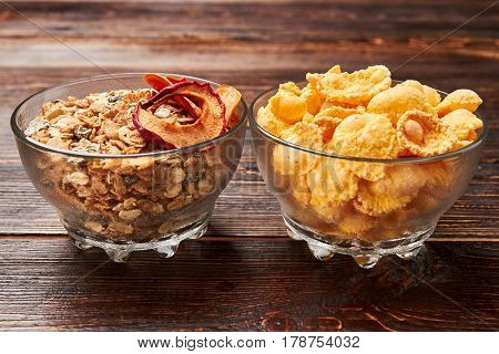 Bowls with cornflakes and muesli. Let's get healthy together.