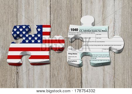 Understanding how to do your taxes Two puzzle pieces with the flag of the USA and a US Federal tax 1040 income tax form on weathered wood 3D Illustration