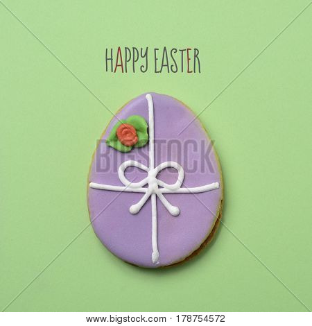 the text happy easter and a cookie decorated as an easter egg against a green background