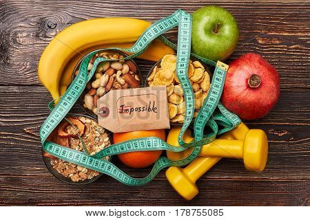Fruits, cereals and sport equiment. Success comes to persevering.