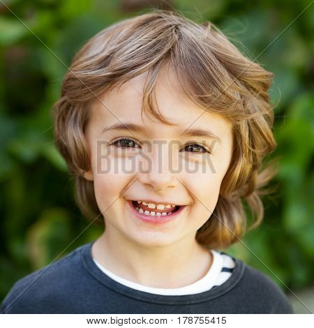 Adorable small child in the field looking at camera
