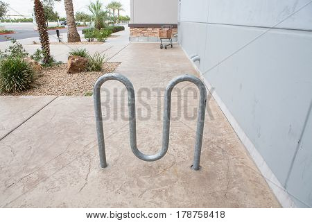 Street Bike Parking - Metal Racks Against Gray Building