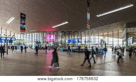 Rotterdam The Netherlands - March 10 2017: Travelers walking in the hall of the railway station of Rotterdam in the Netheralnds.