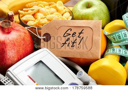 Tonometer, label, dumbbells and fruits. Key to a healthy life.