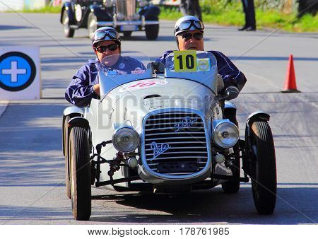 Mignanego Italy - September 25th 2015 - Reenactment 18th Pontedecimo Giovi: Fiat 500B sports conducted by Blacks-Rabitti during a timed regularity 'test.