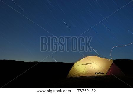NEBRODI PARK, SICILY - MARCH 24, 2017: star trails on lighting semi-geodesic tent Salewa in Nebrodi Park