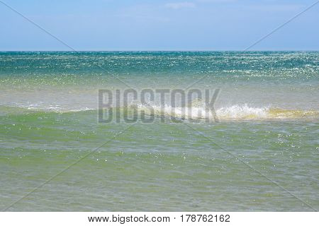 Blue sky leaving for horizon above a blue surface of the ocean waves. Open water. Sea view in sunny summer day.