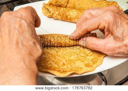 Quinoa crepes preparation :  Rolling up quinoa crepes