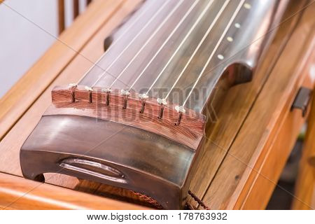 traditional chinese musical instrument name guqin or ku-ch'in zither