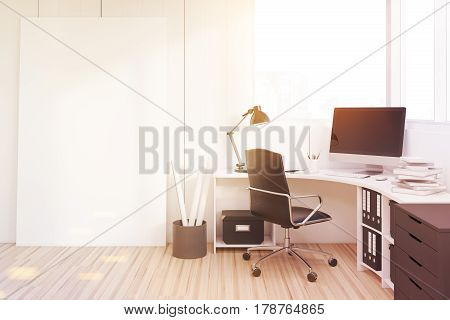 Side veiw of a workplace with a black closet a white table and a desktop standing on it. Concept of office routine. 3d rendering mock up toned image.