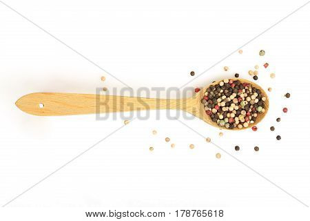 wooden ladle with peppercorns on white background