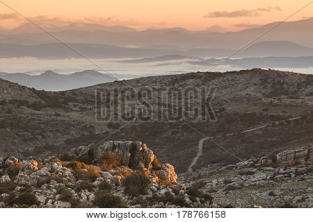 Panoramic view of rocky valley lying in mountains. Torcal in Antequera Malaga.