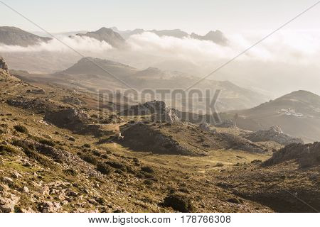 Aerial view of rocky mountains in early morning fog. Antequera Malaga.
