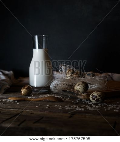 Fresh organic eggs, milk and butter, still life in rustic style, vintage wooden background, selective focus