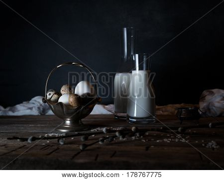 Fresh organic eggs, milk and butter, still life in rustic style, vintage wooden background