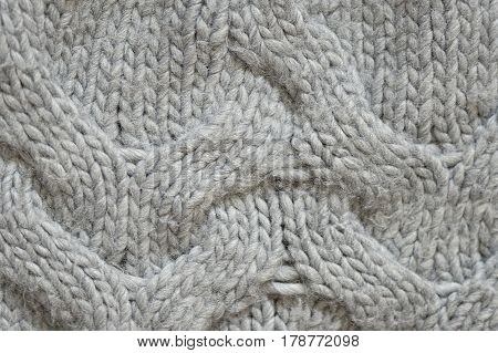 Grey knitted sweater texture close up background