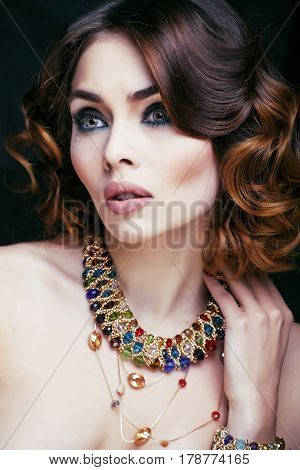 beauty rich woman with luxury jewellery looks like mature close up, bright makeup emotional