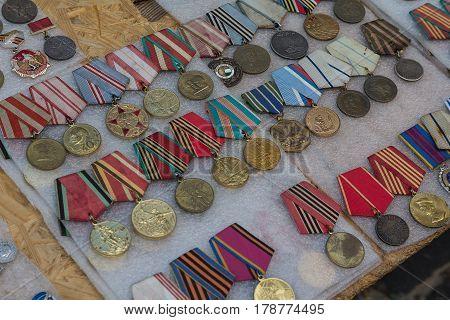 Kiev Ukraine - June 04 2016: Various medals of the Soviet era on the flea market counter on Andreevsky Spusk