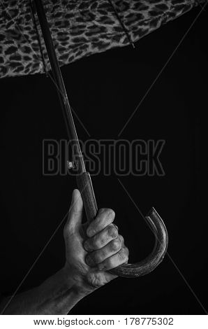 A Man's Hand Holds An Umbrella.
