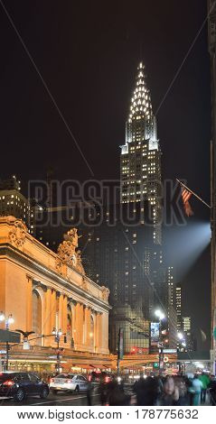 NYC streets at night. Midtown Manhattan - 42nd Street with Grand Central Terminal and Chrysler Building.