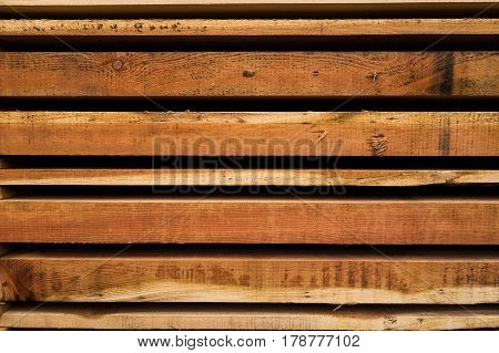 Wooden planks cut at sawmill and stacked in pile ready for use as building material