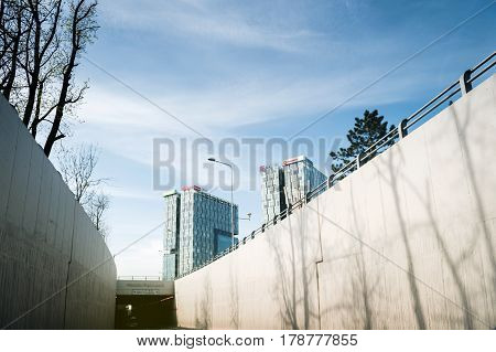 BUCHAREST; ROMANIA - APR 1; 2016: Driver point of view at the entrance of he Pasajul Casa Presei and skyscraper office buildings in the business district of Bucharest