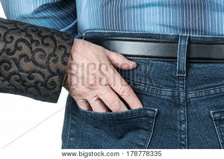 Wrinkled hand of an old woman stuffed into a pocket jeans men