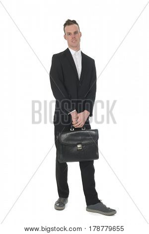 Front view handy young business man standing with briefcase isolated over white background