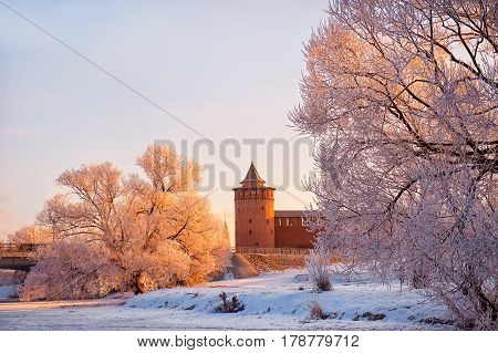 Kolomna Kremlin in winter at sunrise on the background of snow-covered trees at sunrise