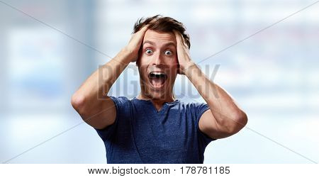 Happy surprised young man