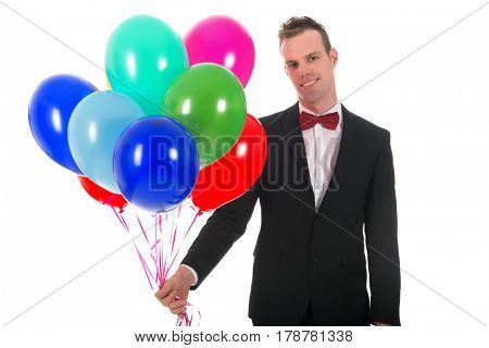 Young man with a bunch of colorful balloons isolated over white background