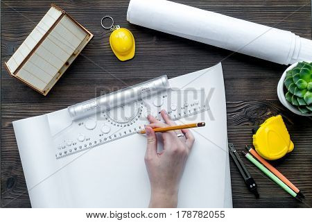 architect office with tools and hands in profession concept on wooden desk background top view