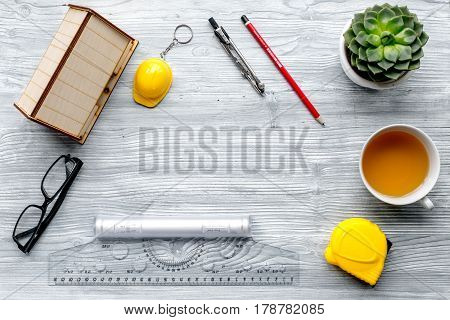 Construction office with architect working tools and glasses on light wooden table background top view mockup