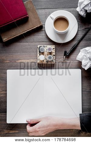 professional writer workplace with tools and cup of coffee on wooden desk background top view