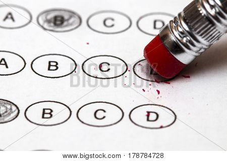 Standardized Quiz Or Test Score Sheet With Multiple Choice Answers Pencil, And Eraser.