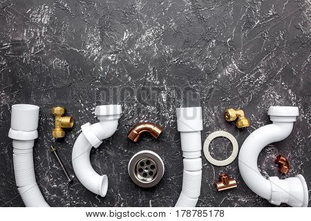 concept plumbing work top view on dark background.