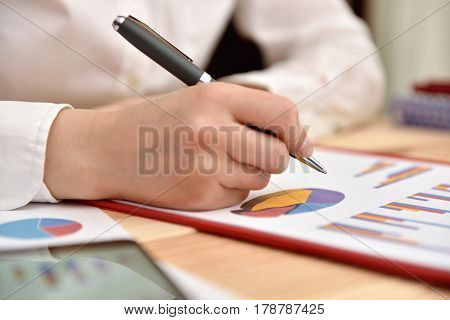 Trader Woman Analyzing Income Graphs