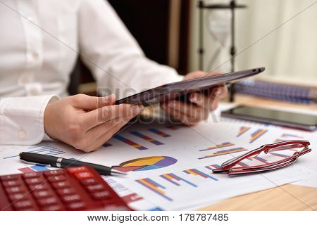 Businesswoman In Office With Digital Table