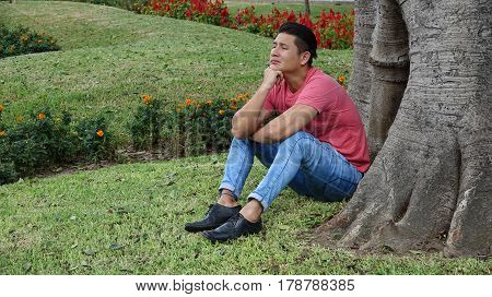 A Young Hispanic Man Sad And Alone