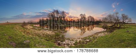Spring Sunset Panorama. Small River In Evening