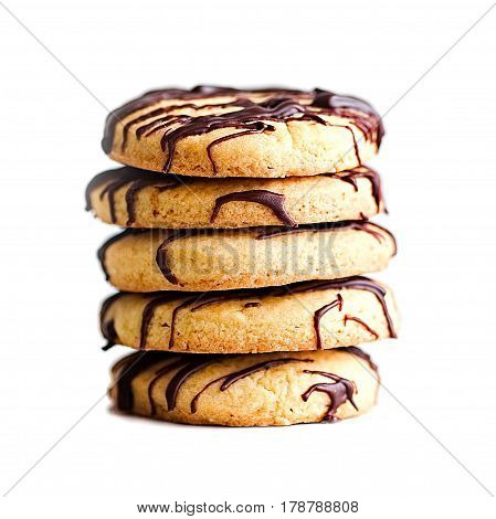 Stack of butter cookies with chocolate drizzle isolated on a white background.