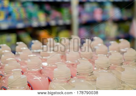 Close up of plastic bottles with liquid soap in supermarket