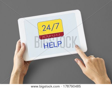 Hands holding digital device with 24/7 service