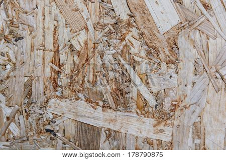 Close-up texture of brown particle board surface