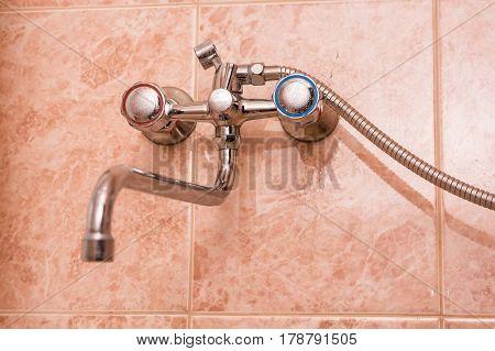 Closeup of modern metal water tap in bathroom