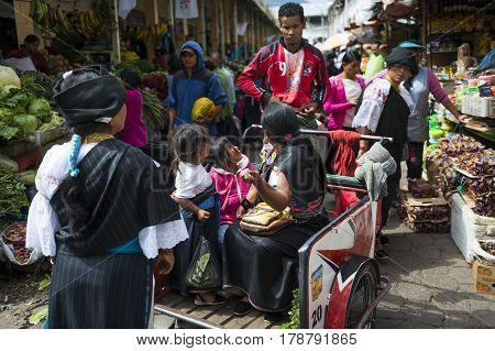 Otavalo Ecuador - February 1 2014: People in a market the town of Otavalo in Ecuador.