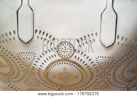Close up of white perforated leather bag texture background