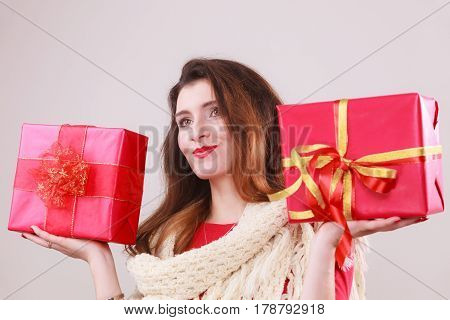 Longhaired woman holding gifts. Two pink boxes. Christmas time. poster